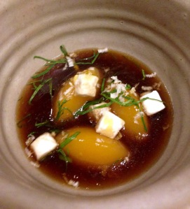 Yellow turnip dumplings, horseradish and parsley with a broth of barbecued mushrooms