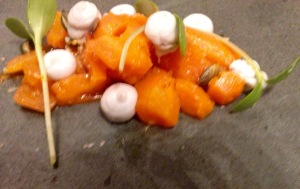 Carrots in coal oil, goats cheese, sunflower shoots and pumpkin seeds